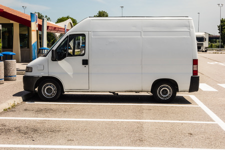 a white van parked in a parking lot photo