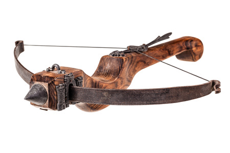 crossbow: an ancient medieval crossbow isolated over a white background Stock Photo