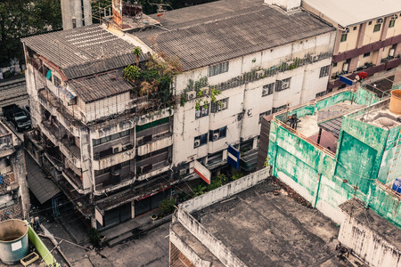 overpopulation: Poor home or slums facade in Bangkok city, Thailand Stock Photo
