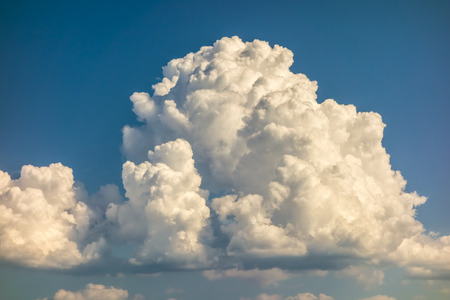 monsoon clouds: a big and fluffy cumulonimbus cloud in the blue sky Stock Photo