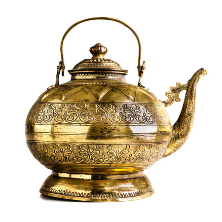 single  object: a vintage Indian or philippine teapot isolated on a white background Stock Photo