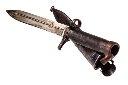 bayonet: an old and rusty bayonet isolated over a white background