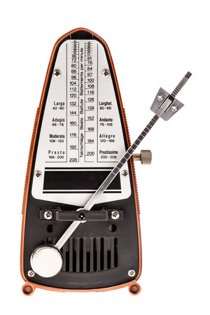 a small metronome isolated over a white background Foto de archivo