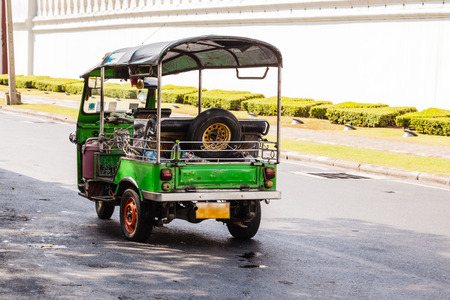 Thai style tricycle called tuktuk or samlor in Thai language. This is an interesting way of transportation, Bangkok, Thailand. photo