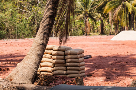 cement pile: a pile of cement sacks in a deforestated area in the thailand countryside Stock Photo