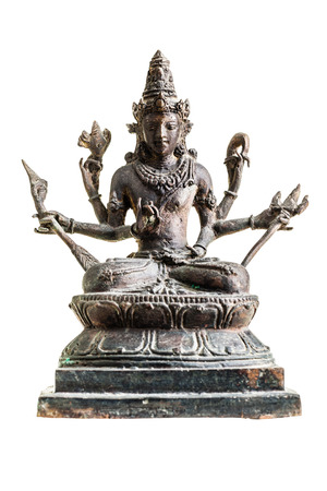 an old statuette of hindu deity vishnu isolated over a white  photo