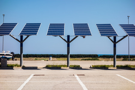 small solar panels over a parking lot in a sunny day