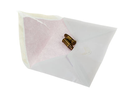 assassinate: two bullet in a mail envelope isolated over a white background Stock Photo