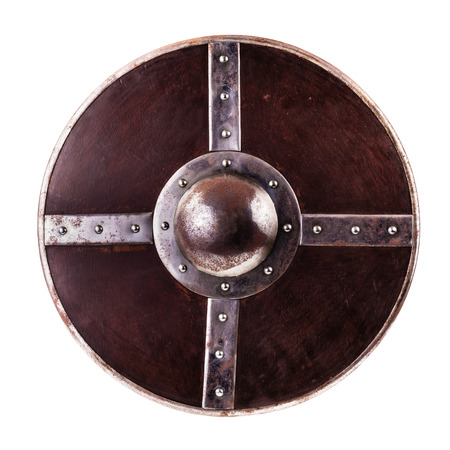 a medieval round iron shield isolated over a pure white background photo