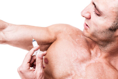 a muscular man giving himself a steroid injection in his arm photo