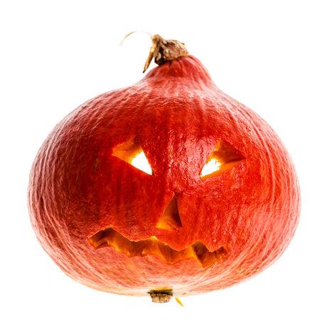 jackolantern: a small Jack-o-lantern halloween decoration isolated over a white background