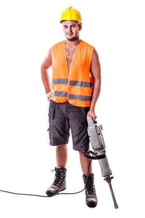a young road worker wearing a hardhat and a visibility vest holding a jackhammer isolated over white background photo