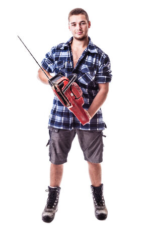 a young lumberjack wearing a checkered shirt and holding a chainsaw isolated over white background photo