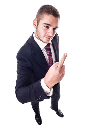 outrage: a young businessman showing the middle finger in a rude gesture isolated over a white background
