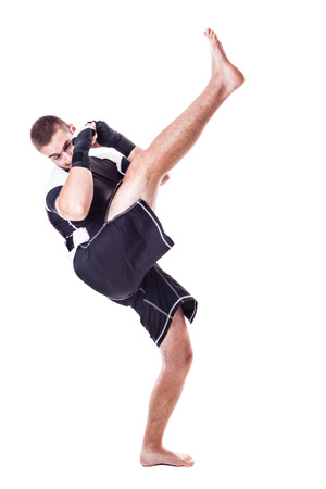 kickboxer: a young kickboxer or boxer isolated over a white background