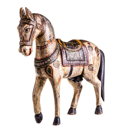 a finely decorated ancient wooden horse isolated over a white background photo