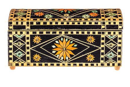 a beautiful decorated ancient bulgarian wooden box isolated over a white background photo