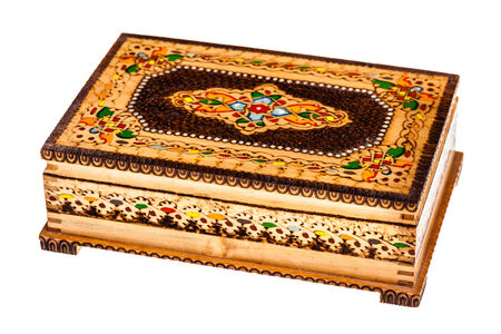 distinguishing: a beautiful decorated ancient bulgarian wooden box isolated over a white background