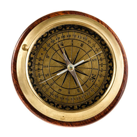 a vintage nautical table compass with golden parts and four needles photo
