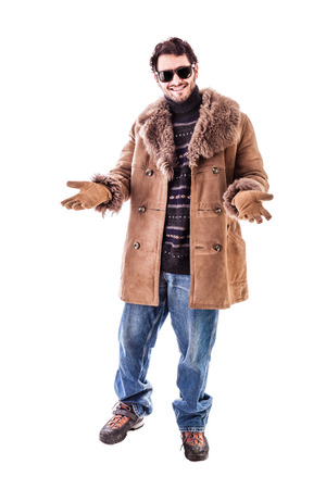 sheepskin: a cheerful young man wearing an expensive sheepskin furry coat isolated over a white background Stock Photo