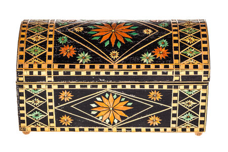 lacquered: a beautiful decorated ancient bulgarian wooden box isolated over a white background