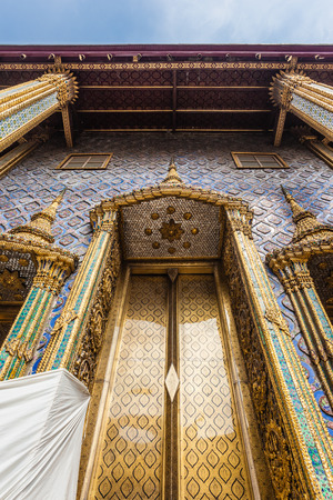 opulence: The ubosot (ordination hall) housing the Emerald Buddha is actually the only original building in the Wat Phra Kaew Stock Photo