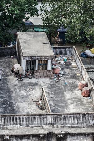 underprivileged: Poor home or slums facade in Bangkok city, Thailand Editorial