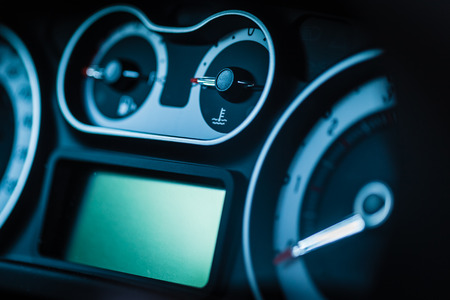 fuel gauge: detail of a modern car dashboard with various gauges Stock Photo