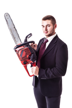 self assured: a young businessman holding a red chainsaw isolated over a white background Stock Photo