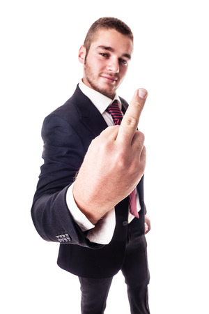 a young businessman showing the middle finger in a rude gesture isolated over a white background photo