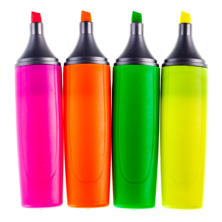 colorful highlighters or markers isolated over a white background