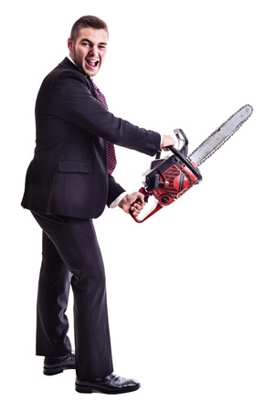 a young businessman holding a red chainsaw isolated over a white background Foto de archivo