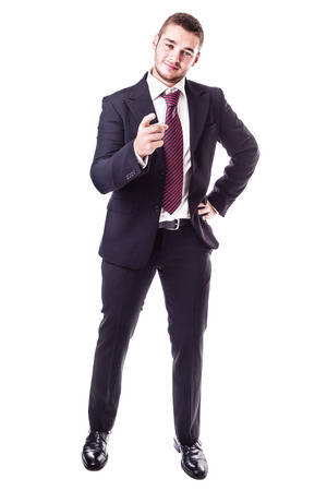 to beckon: a young businessman pointing at you isolated over a white background