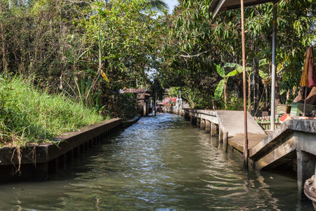 ratchaburi: a canal in the misty thai jungle or countryside in the ratchaburi province