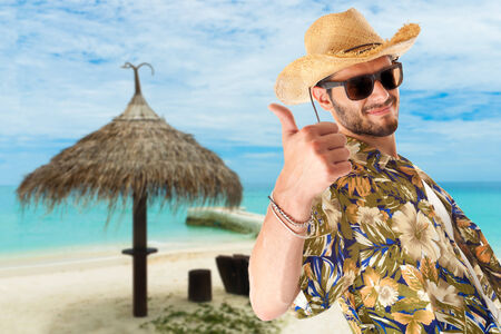stereotype: a young, attractive male in a colorful outfit in a tropical island setting as a stereotype tourist Stock Photo
