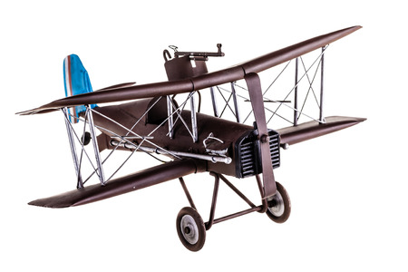 Een oude metalen vliegtuig speelgoed model geïsoleerd op een witte achtergrond Stockfoto - 35117959