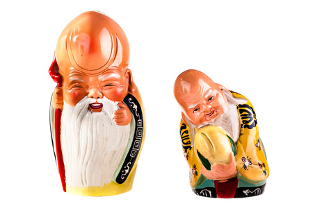 plenitude: Two chinese porcelain elder sage figurines isolated over a white background Stock Photo