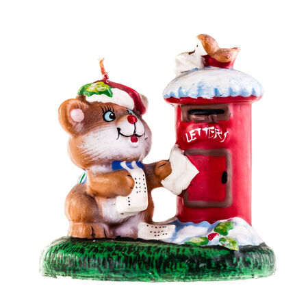 paraffin: a candle shaped as a cat posting a letter in a mailbox isolated over a white background