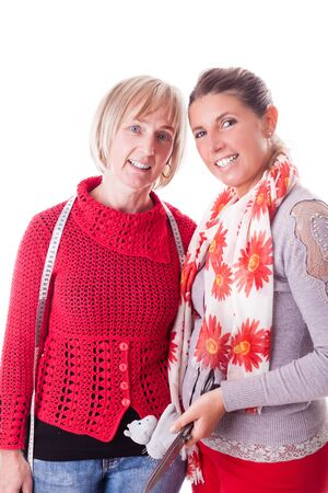 customer tailor: two happy seamstresses isolated over a white background