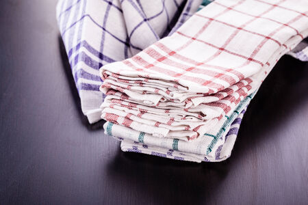 a stack of kitchen dish cloth or canvas in various colors