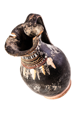 daunia: Apulian black pottery ancient oenochoe isolated over a white background