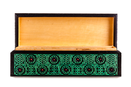 a beautiful decorated ancient bulgarian wooden box isolated over a white background