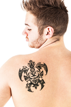 head shoulders: a tattoo on the back of a young man isolated over a white background