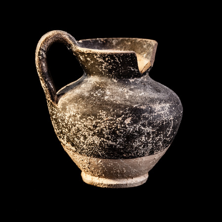 ewer: Apulian black pottery ancient canosan oenochoe isolated over a black background