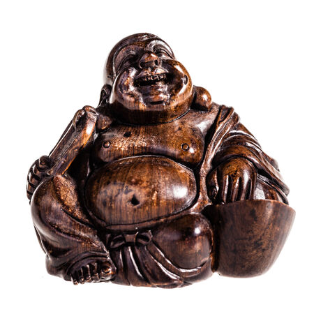 smiling buddha: a wooden smiling buddha isolated over a white background