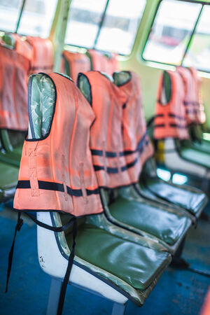 retrieval: life vest jacket on the seats of an old ferry in thailand Stock Photo
