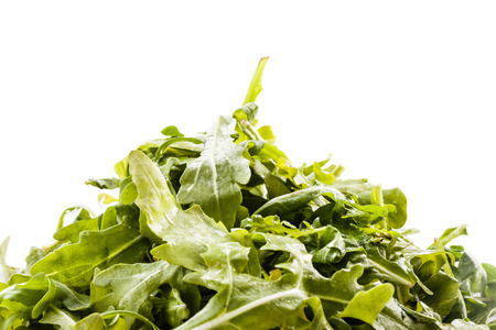 roquette: a heap of roquette salad isolated over a white background Stock Photo