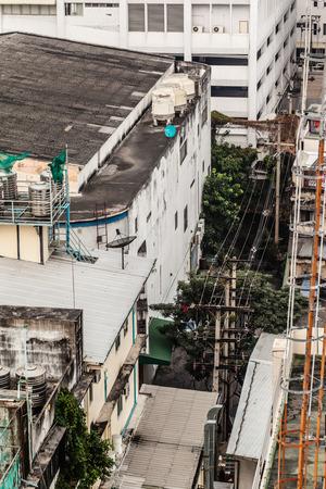 underprivileged: Poor home or slums facade in Bangkok city, Thailand Stock Photo