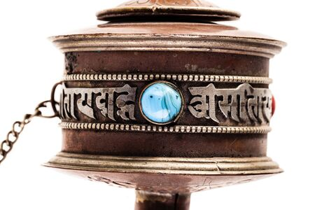 mani: Tibetan Prayer wheel or Mani wheel isolated over a white background