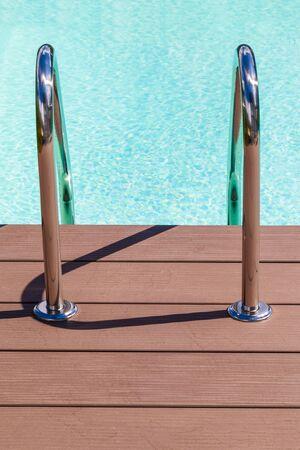pool bars: Grab bars ladder in light blue swimming pool